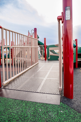 boy sliding down all access park slide   Playground for all abilities and ages in drayton valley alberta, st.anthony school catholic school