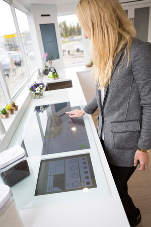 image woman checking out new tech in Telus future home Fiber optics Drayton Valley Commercial photographer